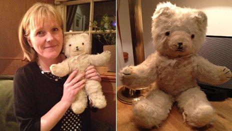"Katie Bell holding her bear ""Nardi"""