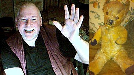 Philip waving at the camera; His old antique bear