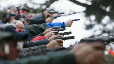 Men shooting for sport
