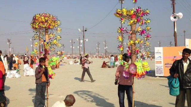 Children selling toys on bank of Sangam