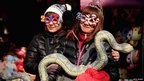 Vendors with a toy snake in Beijing, 9 February