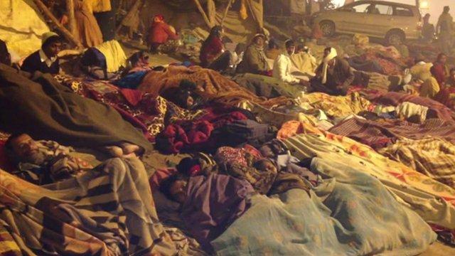 Devotees sleeping in the street