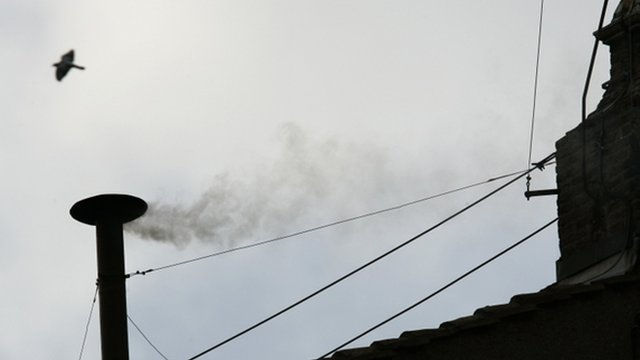 White smoke rising from the chimney above the Sistine Chapel in the Vatican indicating the election of German Cardinal Ratzinger as Pope Benedict XVI