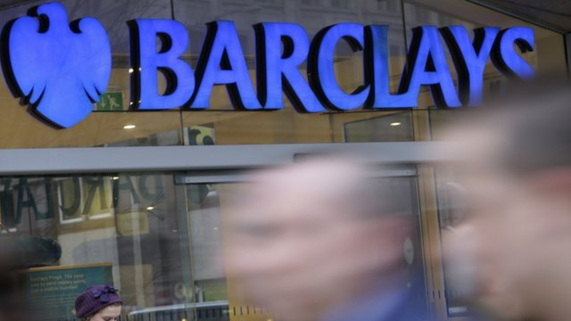 Glowing sign outside branch of Barclays