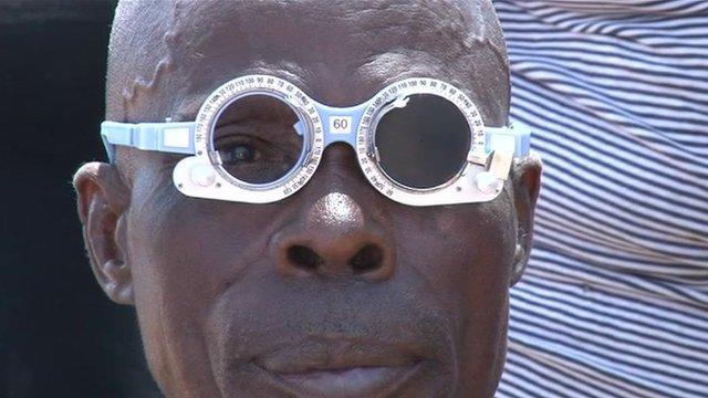 A man having his eyes tested in Kenya