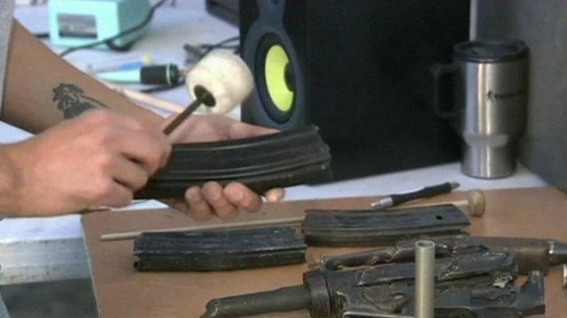 Man beating an empty machine gun magazine