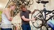 A customer watching a member of staff at Bicycle Space give a  bike maintenance lesson