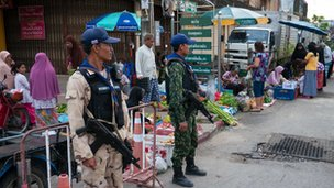 Soldiers at Narathiwat Market in the country's south