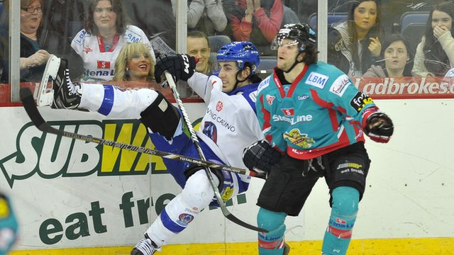 Darryl Lloyd of the Belfast Giants puts a big hit on Benn Olson of the Coventry Blaze in the Elite League game at the Odyssey Arena