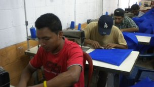 Prisoners sew hammocks