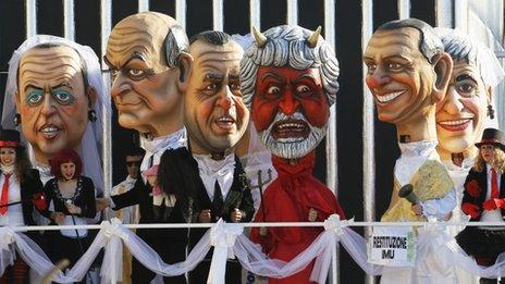 Carnival float with masks of Italian politicians Angelino Alfano, Luigi Bersani, Antonio Di Pietro, Beppe Grillo (devil), Silvio Berlusconi and Niki Vendola