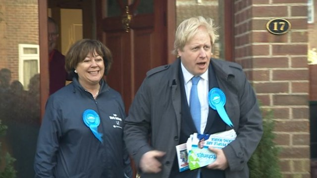 Boris Johnson with Maria Hutchings leaving a voter's house in Eastleigh