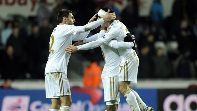 Swansea City's Leon Britton (right) celebrates at the final whistle with teammates during their semi-final second leg match at the Liberty Stadium in Swansea