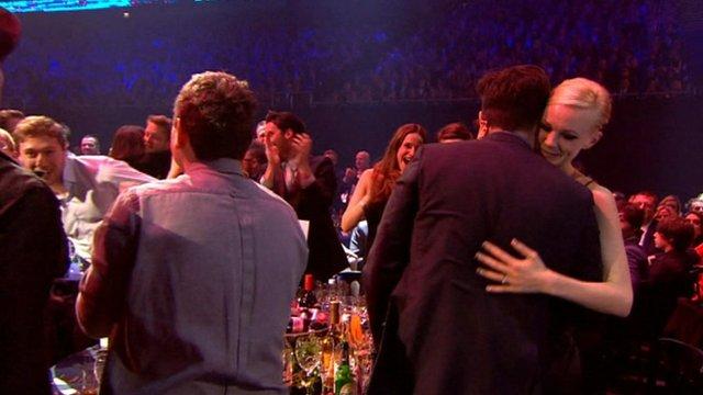 Carey Mulligan gives Marcus Mumford a hug