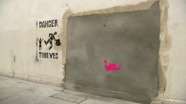 Empty space left by Banksy mural