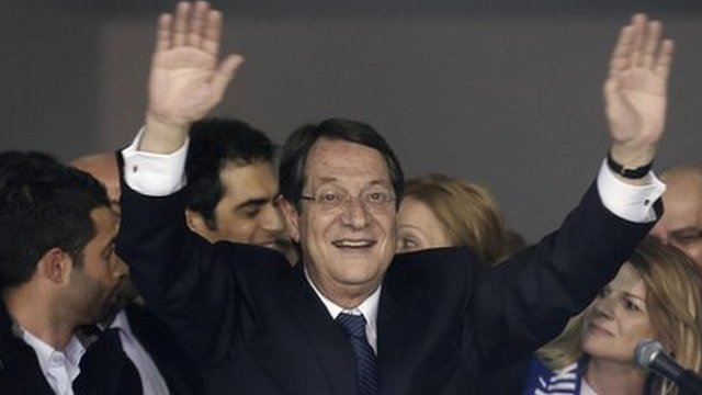 Nicos Anastasiades waves to supporters in Nicosia