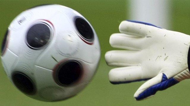 Goalkeeper makes a save