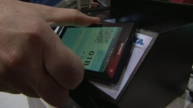 Smart phone being held against NFC-capable device