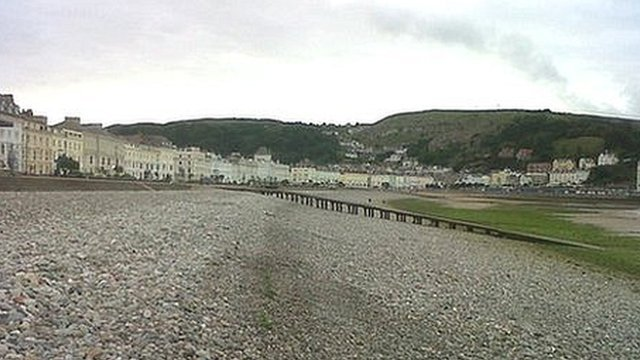 Stones and seaweed on Llandudno's North Shore beach