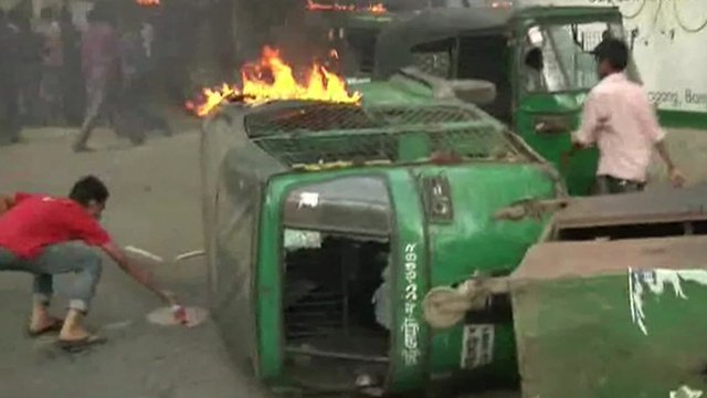 A vehicle on its side and on fire