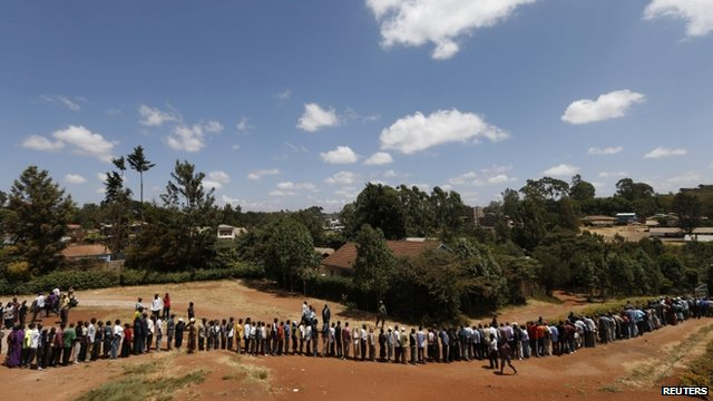 Kenyans wait in line to cast their votes in the Kibera slum in the capital Nairobi