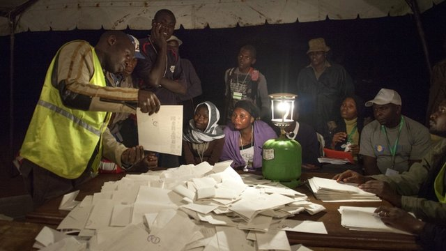 Poll officials count ballots