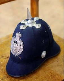 Police helmet with spike