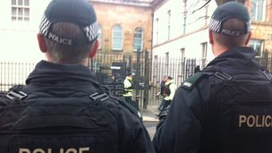 There is a heavy security presence outside the court