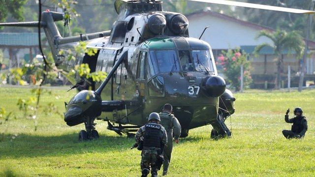 Malaysia Army commandos prepare to board a helicopter
