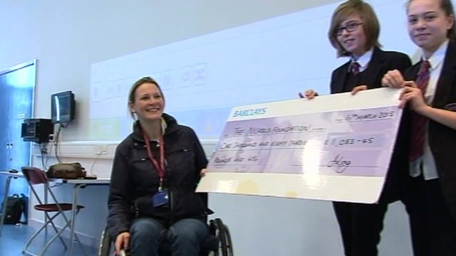 Claire Lomas receiving cheque