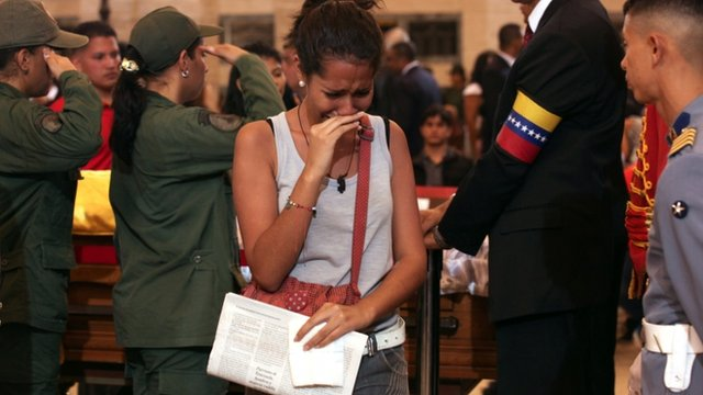 Woman reacting as she pays tribute to the late Venezuelan President Hugo Chavez