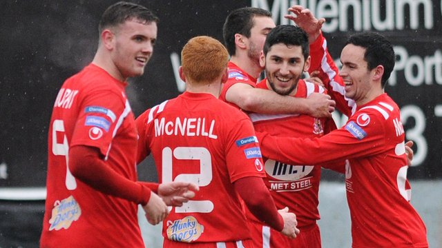 Portadown players celebrate Sean Mackle's goal in the 3-1 victory over Glenavon