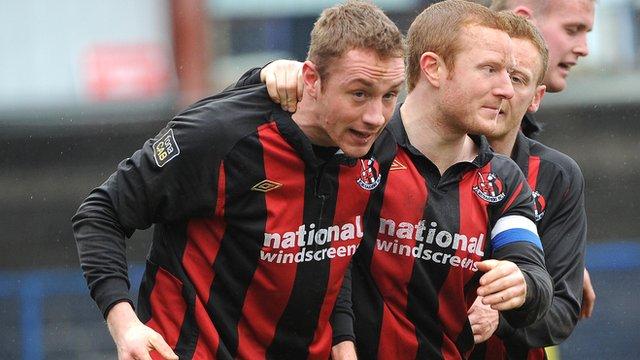 Timmy Adamson celebrates scoring for Crusaders against Coleraine