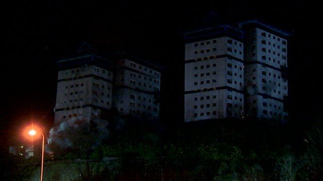 Greenock tower blocks being blown up