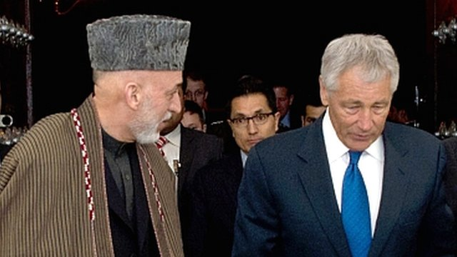 President Hamid Karzai (l) and US Defence Secretary Chuck Hagel (r).