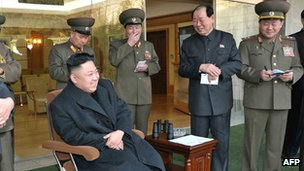 This undated picture released by North Korea's official KCNA on 10 March 2013 shows North Korean leader Kim Jong-un (bottom, left) watching an archery game in Pyongyang
