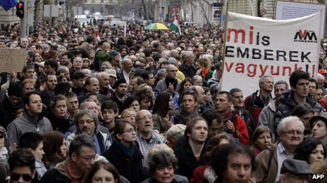 Hungarian NGOs hold up a banner (constitution democracy rule of law) as they protest at changes to the new constitution in Budapest on March 9, 2013.