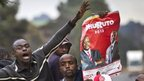 Supporters of Kenyan presidential candidate Uhuru Kenyatta celebrate on the outskirts of Nairobi on 9 March 2013