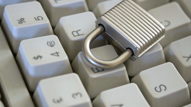 Computer keyboard and padlock