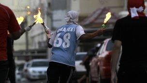 Young Bahrainis retaliate with Molotovs