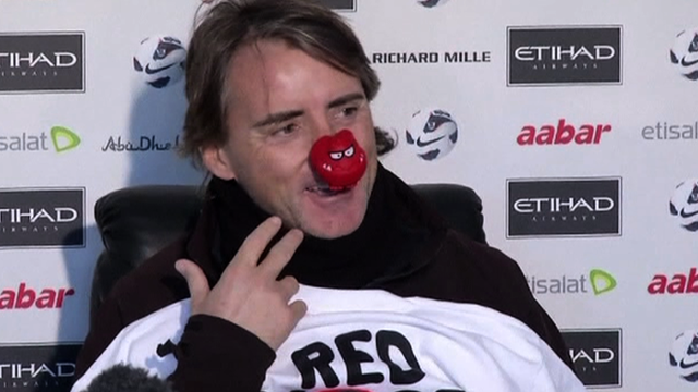 Manchester City manager Roberto Mancini wearing a red nose for Comic Relief