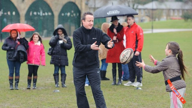 David Cameron plays rugby with children