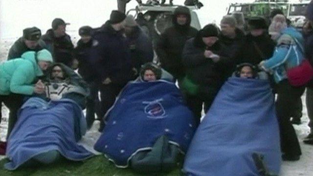 Soyuz crew in blankets