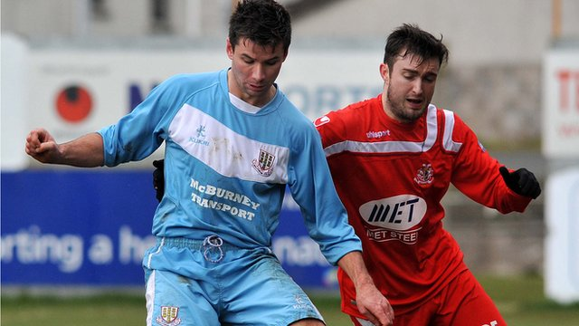 Match action from Portadown against Ballymena United