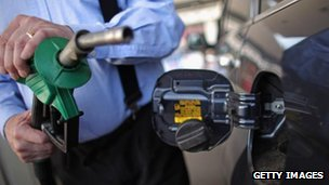 motorist fills up with fuel