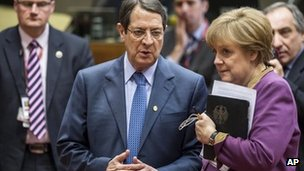 Cypriot President Nicos Anastasiades speaks to German Chancellor Angela Merkel at the EU summit in Brussels, 15 March