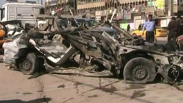 Burned-out car in Baghdad