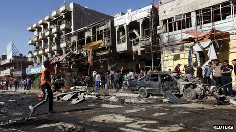 Aftermath of car bombing in the Mashtal district of Baghdad, 19 March 2013