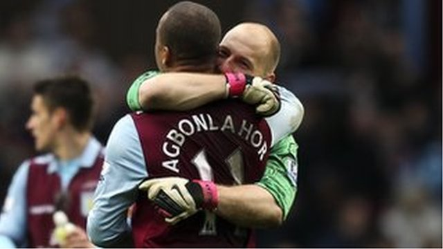 Gabby Agbonlahor and Brad Guzan celebrate at the final whistle after the 3-2 win over QPR