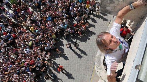 Alain Robert climbing a building